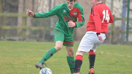 Connor Gordon on the ball for Huntingdon United Reserves in their win against Marchester United.