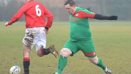 Incoming . . . That's Ben Heath of Huntingdon United Reserves against Marchester United.