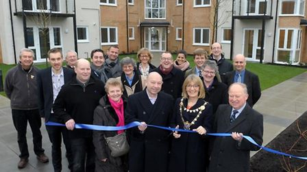 Group image and ribbon cutting at Choristers Court.