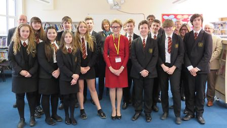 Dame Carol Black, centre, with students, staff and governors at Bassingbourn Village College.