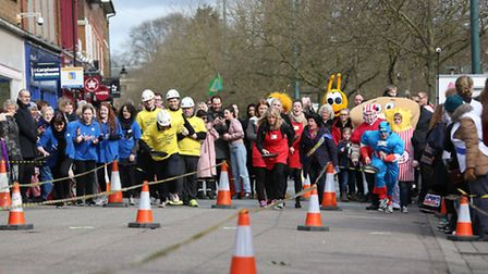 Teams compete in the St Albans pancake race organised in aid of local charity Home Start.