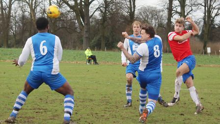 Harry Hunt scoring the first of his two goals for Skew Bridge against Nicholas Breakspear.