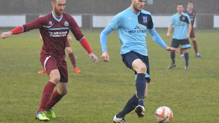 Arran Mackay in action for Godmanchester Rovers in their defeat to Kirkley & Pakefield earlier this