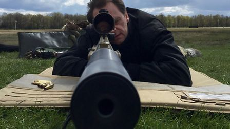 Nigel Cooper learning how to shoot a sniper