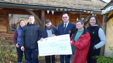 Batchwood Hall Golf Club captain Ivor Thomas handing the cheque to Earthworks. Supplied by Ivor Thom