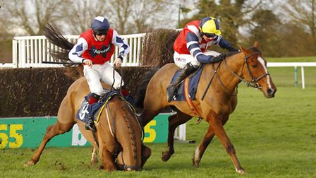 Final fence drama in the 188Bet Cambridgeshire National at Huntingdon Racecourse as Wood Yer (left)