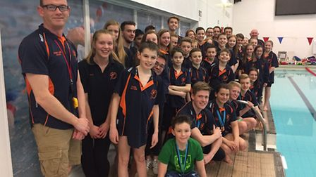 Members of St Ives Swimming Club celebrate their successes at the Cambridgeshire County Championship