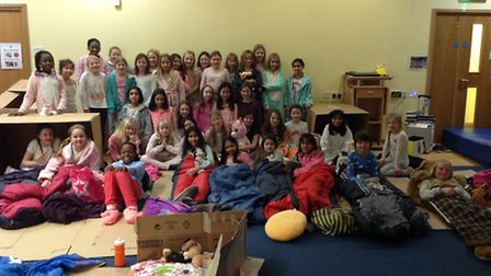 Girls at St Albans High School Prep sleeping over at school for charity.