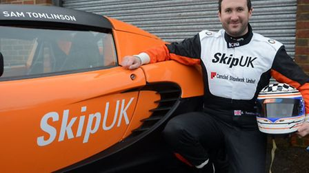 Sam Tomlinson with the car he will race in the Lotus Elise Trophy this year.