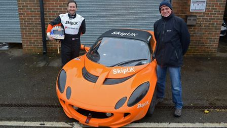 Papworth racer Sam Tomlinson with Barry Dean, managing director of backers Skip UK.