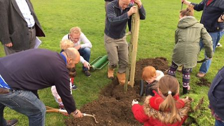 People from the community planting the trees. Supplied by Robert Dunster.