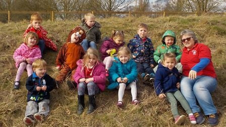 Sharon McGinty with children in the Ladybird Playgroup's new Wild Space area.
