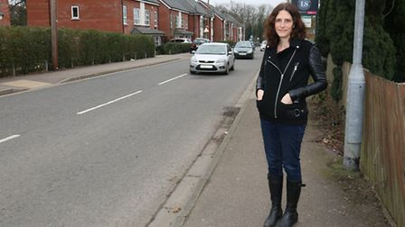 Nicola MacKinnon on a busy stretch of Hill End Lane where her son was hit by a car.