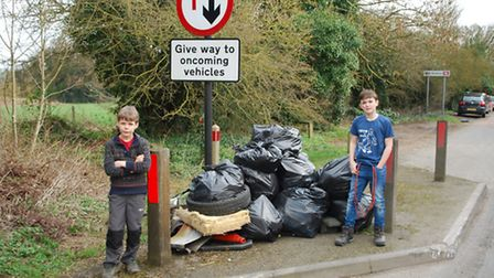 Freddie Belson, 9, and 10-year-old Eli Curtin went along to help the clean-up effort