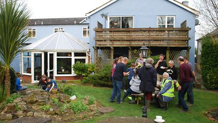 The litter pickers enjoying a complimentary cup of tea afterwards in the garden of the Jester, Odsey