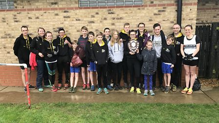 The Huntingdon BRJ Run & Tri junior squad, and their coaches, after winning the final race of the Fr