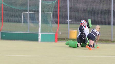 Goalkeeper Ness Brown makes a save during St Ives Ladies 1sts' victory against Haverhill.