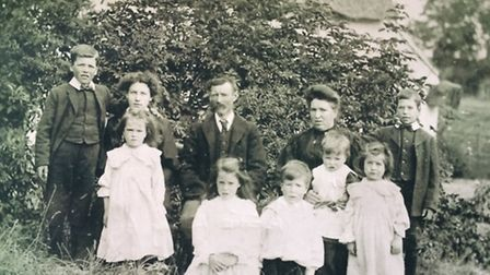 Samuel James Ray, far left, as a youngster with his family