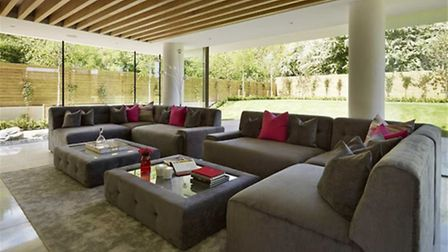 The spacious living area opens out onto the private garden (Credit: RightMove)