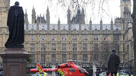 An Air Ambulance outside the Palace of Westminster, London, after sounds similar to gunfire have bee