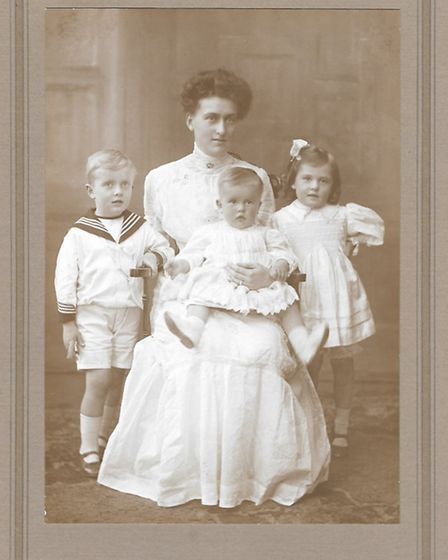 A childhood photo of Lily Winter in about 1910, with her twin and sister.
