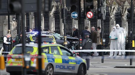 Emergency personnel close to the Palace of Westminster, London, after policeman was stabbed and his