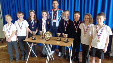 Daniel Fogg presented swimming awards to children at How Wood Primary School