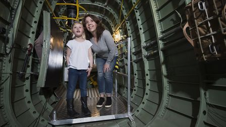 Visitors inside the Lancaster that is currently at IWM Duxford.