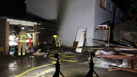 Firefighters at the scene of the garage fire in Wheathampstead. Picture credit: @WhiteWatchWGC
