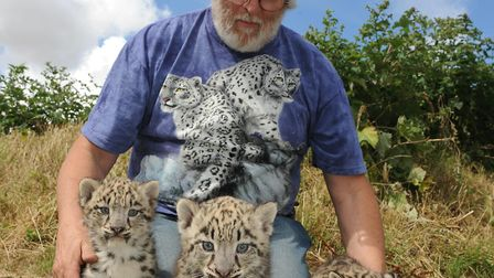 Terry Moore with snow leopard cubs