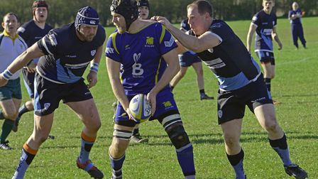 Action from St Ives's clash against Huntingdonshire rivals St Neots.
