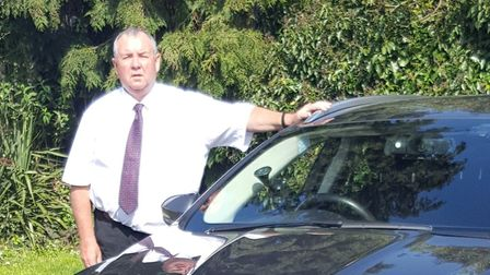 Dave McCormack with his minicab