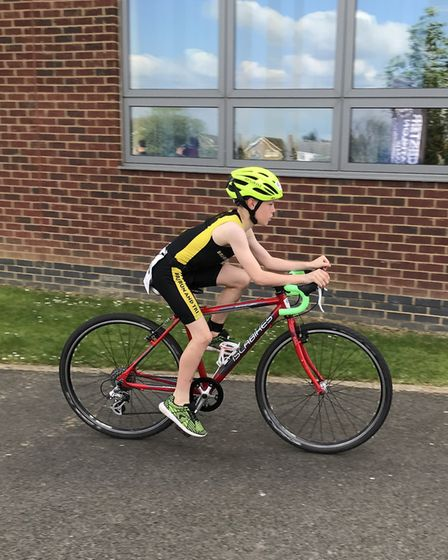 Liam Conway of Huntingdon BRJ Run & Tri on his way to category success at the Duston Junior Triathlo