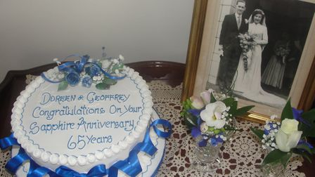 Celebration cake and photo of their wedding day on April 5 1952.