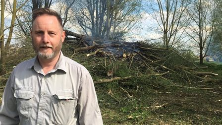 Paul Croydon with one of the debris piles at the park
