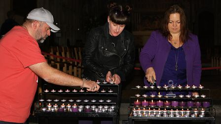Prince's Anniversary - Perry Gorton/Alison Blakeburn and Bev Knight light purple candles in memory o