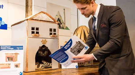 Cat's whiskers: Joey Childs, cat home specialist, shows Colin what's on the market as he takes a loo