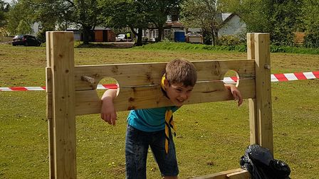 Scouts enjoyed old-fashioned activities and games including having a go in the stocks. Picture: Mark