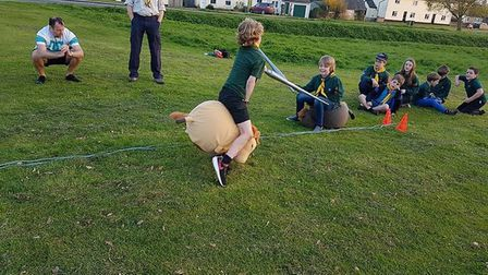 The scout group have a go at jousting. Picture: Mark Sesco