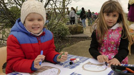 Kira Levay, age 4, and Zosia Stez, age 5, enjoy some drawing at Coneygear Park.