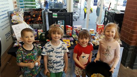 Children helping out at the Friends of Reed School's chocolate tombola fundraiser at Tesco Extra in