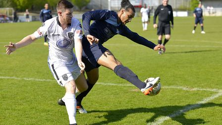 Lewis Wilson battles for the ball during St Neots Town's loss to Merthyr. Picture: DUNCAN LAMONT