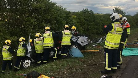 Driver cut from wreckage following collision at Leighton Bromswold
