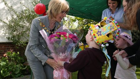 The Mayor of St Albans cllr Frances Leonard is presented with some flowers by children and staff at