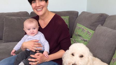 Jenny Wickett, with baby Samuel and the family pet