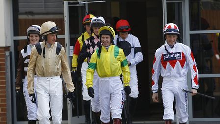 Jockeys, including Richard Johnson (centre, yellow) leave the weighing room during the final fixture