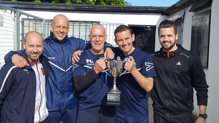 London Colney's coaching staff celebrate winning the League Challenge Trophy.