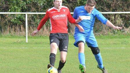 Warboys Town man Dan Moulds (left) struck both their goals in the 2-2 draw which clinched promotion.