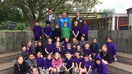 Pupils from Cunnigham Hill Junior School together with tennis coach Dan Smith (centre) and Duncan Co