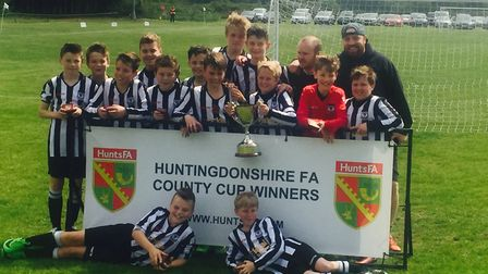 Buckden Harriers Under 12s celebrate their Hunts Cup success.